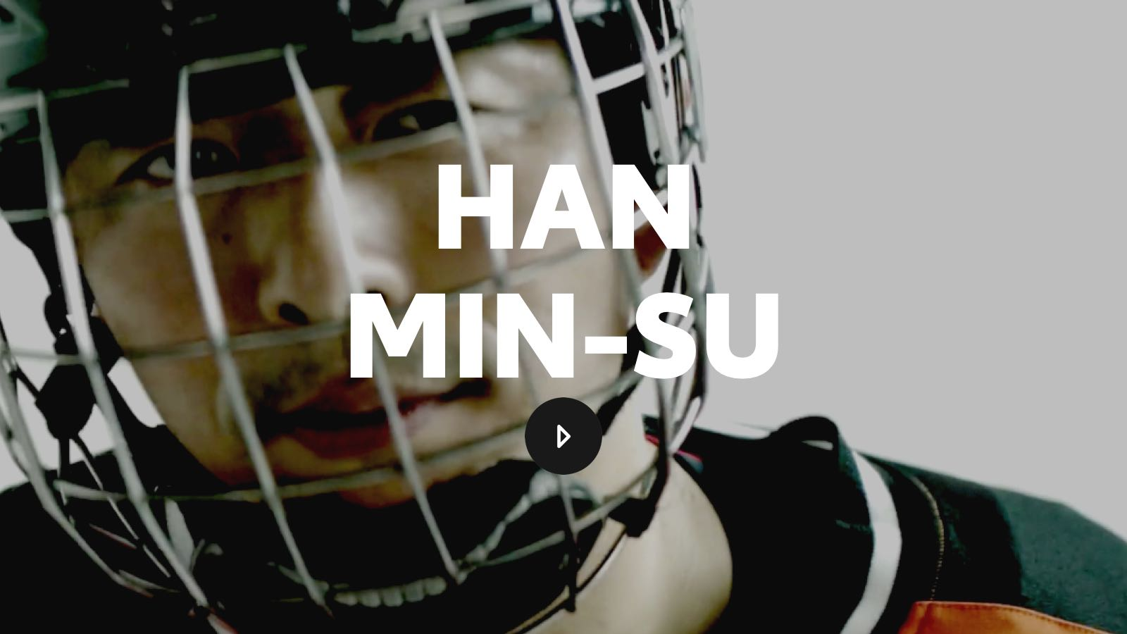 Han Min-Su looks ready to compete behind the cage of his hockey facemask.