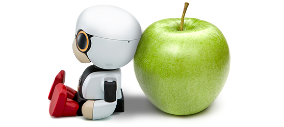 Kirobo Mini next to an apple