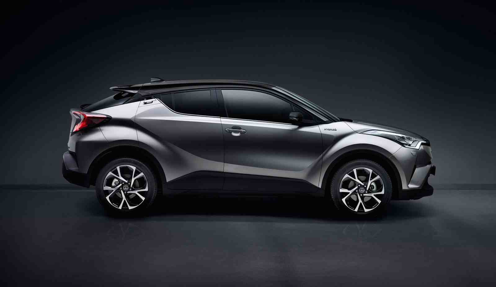 Toyota C-HR, exterior Silver, side view, black background.