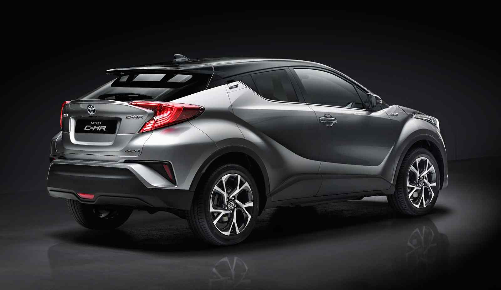 Toyota C-HR, exterior Silver, side back view, black background.