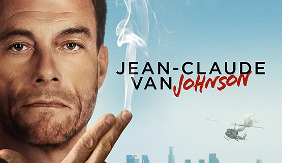 Jean-Claude Van Johnson with helicopter falling over city in background and smoking fingers