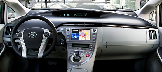 Toyota Prius, interior, grey coloured leather steering wheel, control panel & gear stick on display.