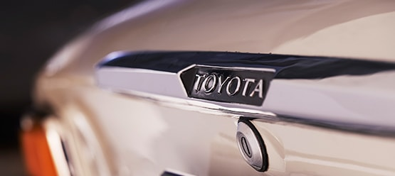 Toyota Corolla, exterior White, diagonal view, close-up of boot of the vehicle.
