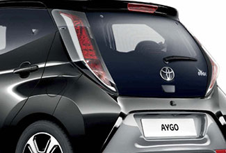 Toyota Aygo, exterior side back view, Black, white background