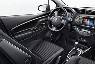 Toyota Yaris, interior, leather steering wheel, control panel, glove compartment & gear stick on display