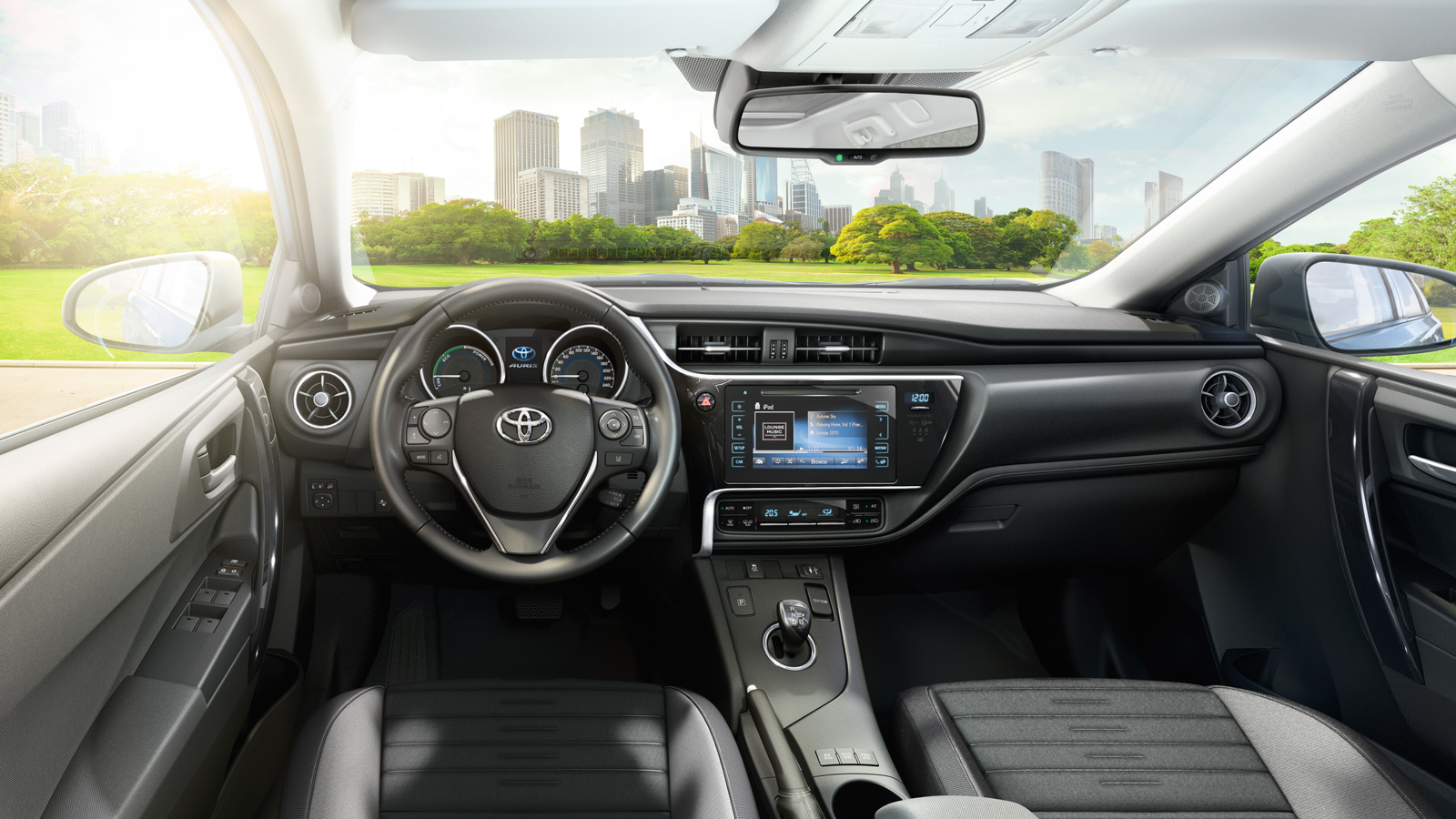 Toyota Auris, interior, leather steering, front seating area & all other functions normally at the front of car on display, daytime city outdoor background shot.