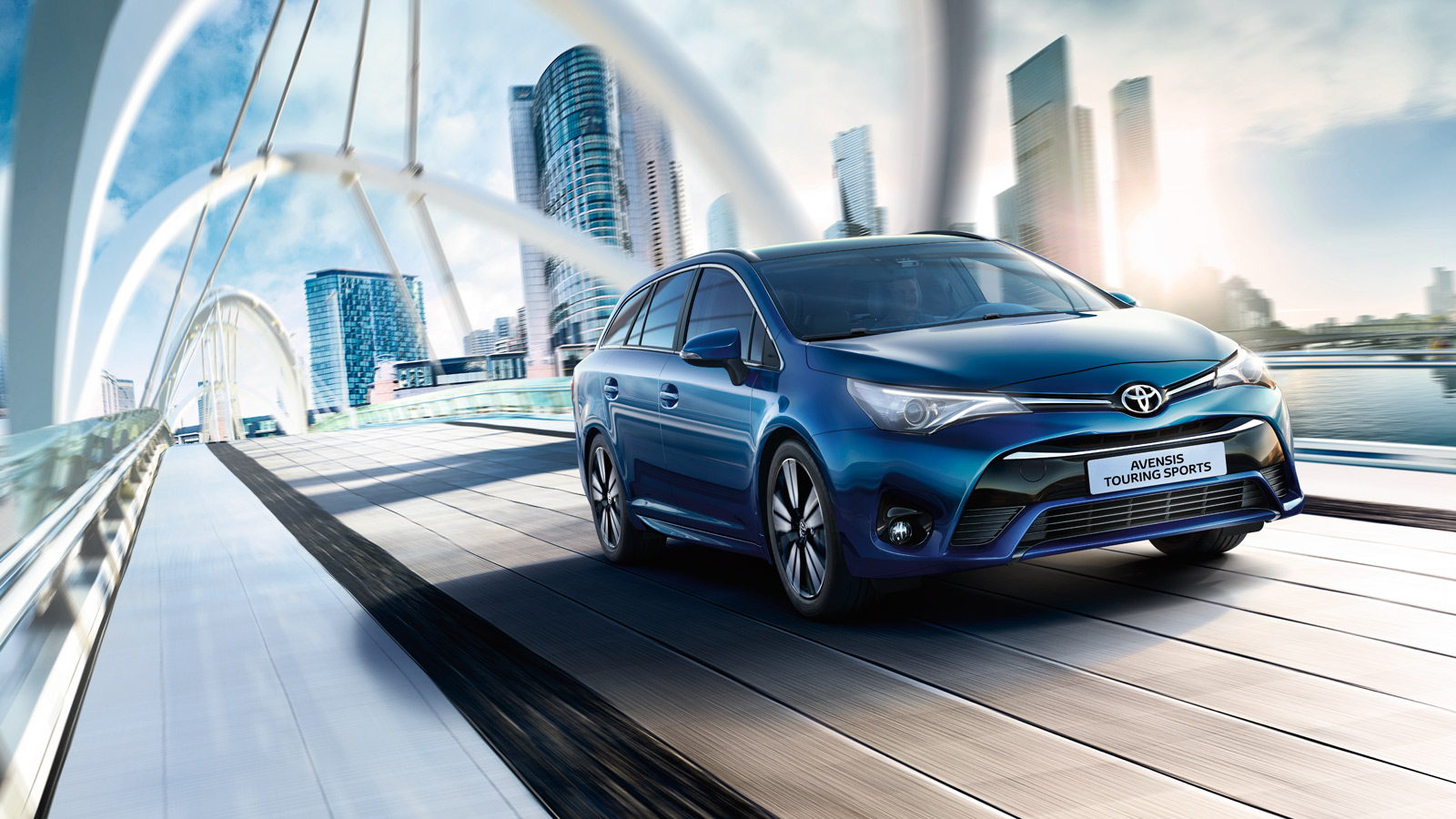 Toyota Avensis exterior, Blue, front side view, driving over a bridge, daytime city background
