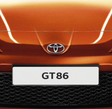 Toyota GT86, exterior Orange, front view, animated background